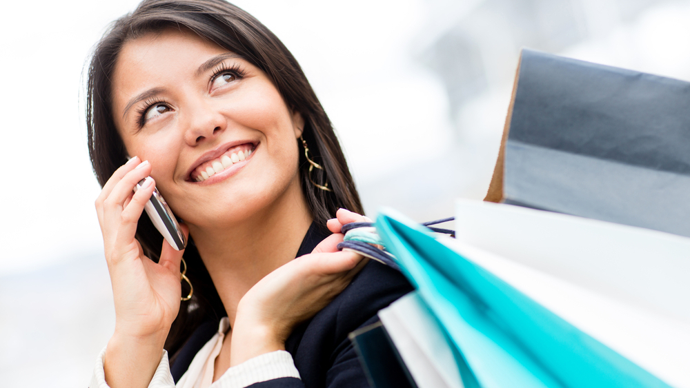 woman-talking-on-cell-shopping