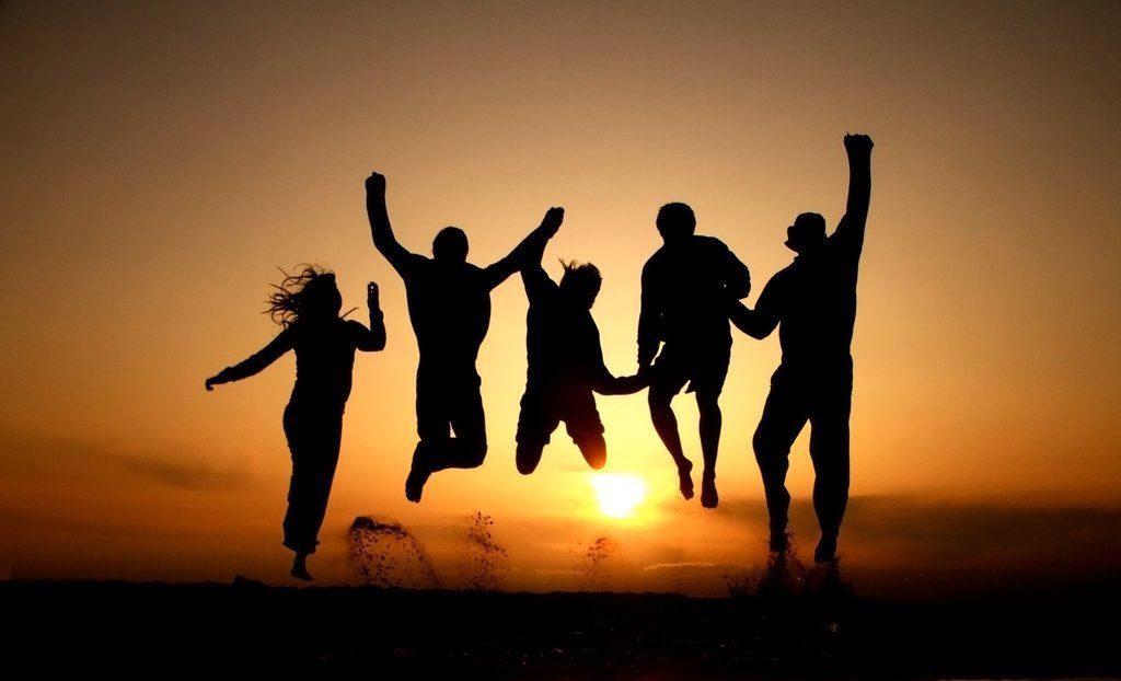 happy-people-jumping-sunset